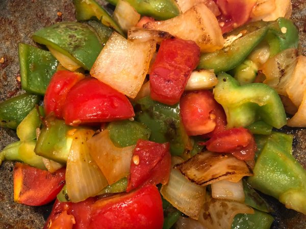 Finally add the tomato pieces, and stir for a couple of minutes. Make sure they don't turn mushy