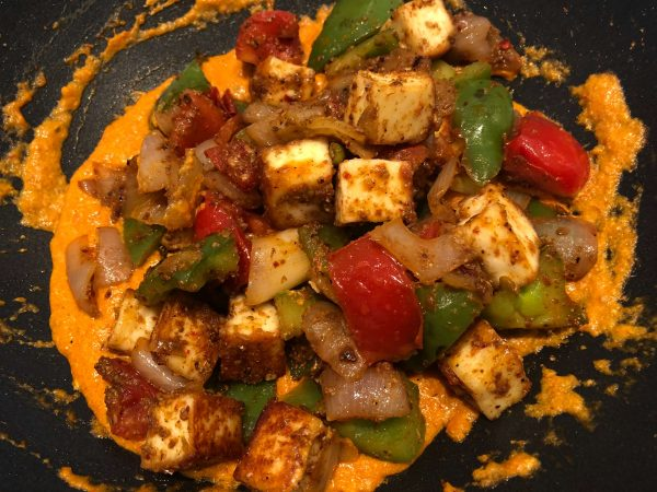 Now, add the vegetable + paneer mix and gently toss everything together to evenly coat the veggies/paneer mix