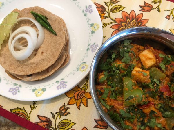 Serve with phulkas and sliced onions and lime wedges