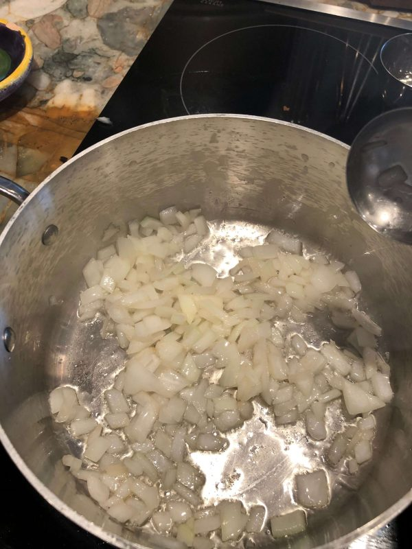 Heat oil in a large bowl; saute the onions when hot; sprinkle a little bit of the salt
